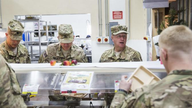 Brigadier General Bentley serves U.S. soldiers from the 3rd Cavalry Regiment food during a Christmas day lunch at forward operating base Gamberi in the Laghman province of Afghanistan