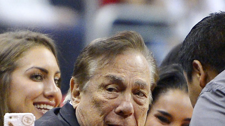 FILE - In this Oct. 25, 2013 file photo, Los Angeles Clippers owner Donald Sterling gestures as the Clippers play the Sacramento Kings during the first half of an NBA basketball game in Los Angeles. The future of the Clippers is closer to decision as testimony resumes Monday, July 21, 2014, in a probate trial over whether a deal negotiated by Donald Sterling's estranged wife to sell the team for $2 billion is authorized under a Sterling family trust. (AP Photo/Mark J. Terrill, File)