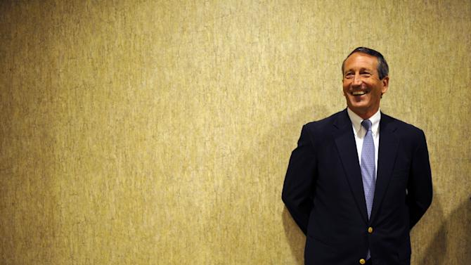 Former South Carolina Gov. Mark Sanford leans against a wall as he waits before the 1st Congressional District debate on Monday, April 29, 2013 in Charleston S.C. (AP Photo/Rainier Ehrhardt)