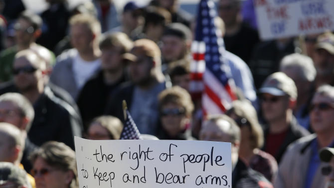 """Gun rights advocates demonstrate on Saturday, Jan. 19, 2013, in Nashville, Tenn. Supporters of gun rights held """"Guns Across America"""" rallies across the country Saturday in response to President Barack Obama's plan to curb gun violence. (AP Photo/Mark Humphrey)"""