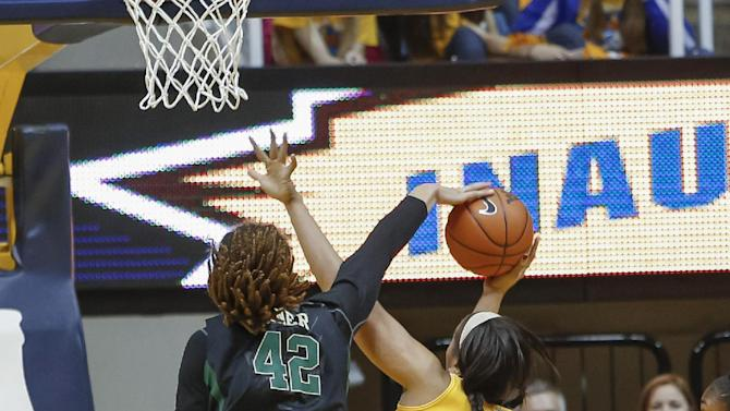 Baylor's Brittney Griner (42) blocks the shot of West Virginia's Ayana Dunning (33) during the first half of an NCAA college basketball game in Morgantown, W.Va., on Saturday, March 2, 2013. (AP Photo/David Smith)