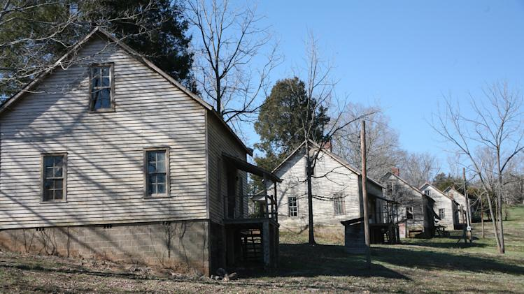 """This undated image provided by VisitNC.com shows the abandoned Henry River Mill Village in Hildebran, N.C., where scenes from """"The Hunger Games"""" were shot. The house on the left was outfitted as the Everdeens' home in the Seam, part of District 12 in fictional Panem. (AP Photo/VisitNC.com, Margo Metzger)"""