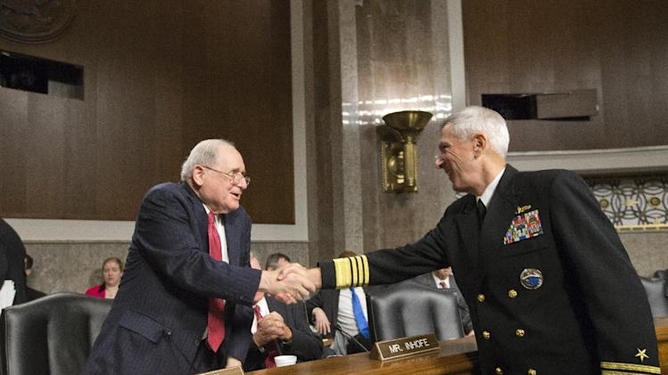 Senate Armed Services Committee Chairman Sen. Carl Levin, D-Mich., left, welcomes Adm. Samuel Locklear, commander of U.S. Pacific Command, on Capitol Hill in Washington, Tuesday, April 9, 2014, prior to Locklear testifying before the committee's hearing focusing on the Korean peninsula as it reviews defense authorization requests for fiscal year 2014. (AP Photo/J. Scott Applewhite)