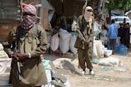 Shebab militants patrol in southern Mogadishu's Bakara market on June 29, 2009. Somali Islamists say they have decided to execute the French intelligence officer they have held for more than three years and who was the object Saturday of a botched rescue bid