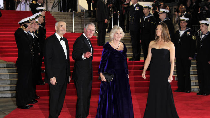"Michael G. Wilson, from left, Prince Charles, Camilla Parker-Bowels and Barbara Broccoli arrive at the world premiere of ""Skyfall"" at the Royal Albert Hall on Tuesday, Oct. 23, 2012 in London. (Photo by Joel Ryan/Invision/AP)"