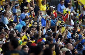 Uruguay fans holds masks with the face of banned Uruguayan…