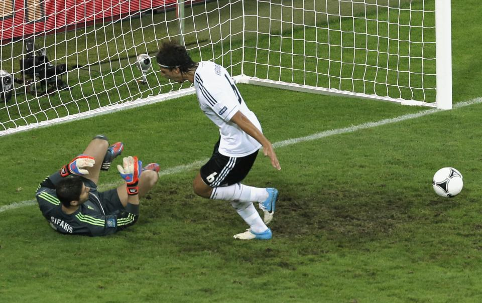 Germany's Sami Khedira celebrates after scoring his side's second goal past Greece goalkeeper Michalis Sifakis, left, during the Euro 2012 soccer championship quarterfinal match between Germany and Greece in Gdansk, Poland, Friday, June 22, 2012. (AP Photo/Gero Breloer)