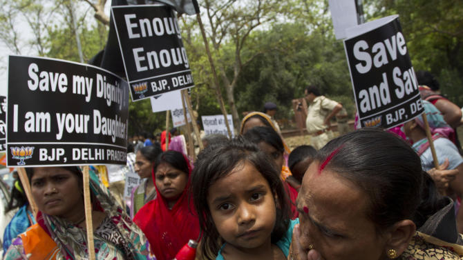 Activists of India's main opposition Bharatiya Janata Party hold placards near the residence of ruling Congress party President Sonia Gandhi during a protest against the rape of a 5-year-old girl in New Delhi, Sunday, April 21, 2013. The girl was allegedly kidnapped, raped and tortured by a man and then left alone for two days in a locked room in India's capital. (AP Photo/Tsering Topgyal)