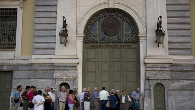 Pensioners line up at the main gate of the national bank of Greece as they wait to withdraw a maximum of 120 euros ($134) for the week in central Athens, Tuesday, July 7, 2015. Greek Prime Minister Alexis Tsipras heads Tuesday to Brussels, where he will try to use a bailout referendum victory to obtain a rescue deal with European leaders. (AP Photo/Emilio Morenatti)