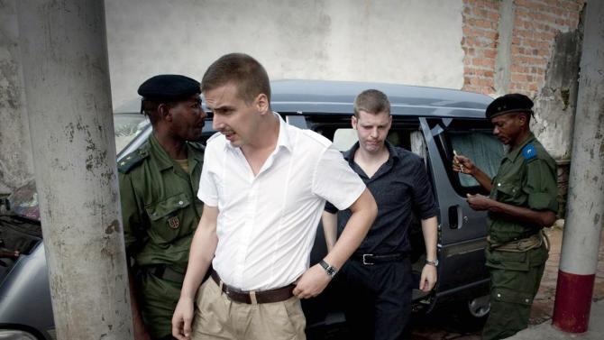 FILE- Norwegian citizens Tjostolv Moland, left, and Joshua French, right, arriving for their trial process in Kisangani, Congo, in this file photo dated Thursday Dec. 3, 2009, on charges of killing their driver Abedi Kasongo, espionage, armed robbery and organised crime. According to government officials and his lawyer Sunday Aug. 18, 2013, Moland has died in prison, aged 32. The cause of death wasn't immediately clear, attorney Hans Marius Graasvold said, while also declaring that British-Norwegian citizen Joshua French, who was imprisoned alongside Moland, is upset but in good health. (AP Photo, FILE) NORWAY OUT