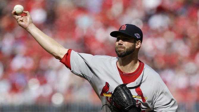 St. Louis Cardinals starting pitcher Chris Carpenter throws against the Washington Nationals in the first inning of Game 3 of the National League division baseball series on Wednesday, Oct. 10, 2012, in Washington. (AP Photo/Alex Brandon)