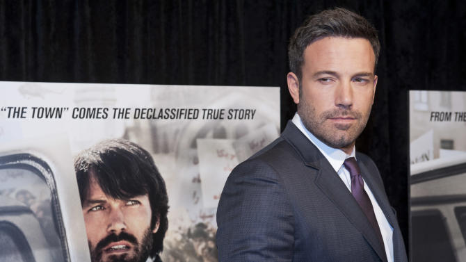 """FILE --In this Wednesday, Oct. 10, 2012 file photo, director and actor Ben Affleck poses for photographers at the premiere of his film Argo in Washington, DC, USA. Iranian media reported on Tuesday, March 12, 2013 that authorities are planning to sue Hollywood over the Oscar-winning """"Argo"""" because of the movie's allegedly """"unrealistic portrayal"""" of the country. The decision on the lawsuit came after a group of Iranian cultural officials and movie critics screened the film in a closed audience in a Tehran theater late Monday. (AP Photo/Cliff Owen, File)"""