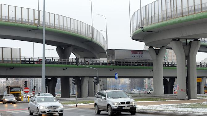 CORRECTS HEADER - Cars drive past a multi-level intersection in Warsaw, Poland, Wednesday, Jan. 9, 2013.  Poland is launching Wednesday a government program to reduce traffic fatalities and improve its horrible road safety record. In 2011, Poland had Europe's worst road safety statistics, with 110 deaths per 1 million citizens, or almost 4,200 people killed, and one in five road deaths in all of Europe happened in Poland. (AP Photo/Alik Keplicz)