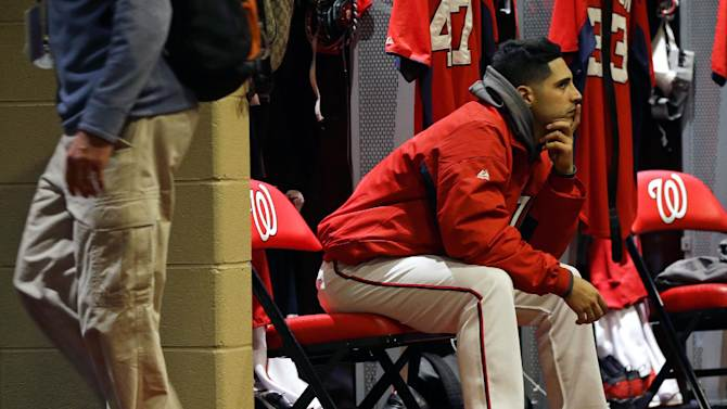 Washington Nationals starting pitcher Gio Gonzalez sits in the locker room after Game 5 of the National League division baseball series against the St. Louis Cardinals on Saturday, Oct 13, 2012, in Washington. St. Louis won 9-7. (AP Photo/Pablo Martinez Monsivais)