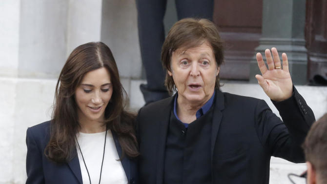 Sir Paul McCartney and wife Nancy Shevell leave after the presentation of his daughter British fashion designer Stella McCartney's ready to wear Spring-Summer 2013 collection, in Paris, Monday, Oct. 1, 2012. (AP Photo/Michel Euler)
