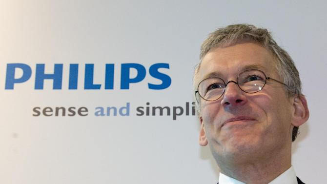 Philips CEO Frans van Houten smiles as he poses for photographers when arriving for a press conference in Amsterdam, Netherlands, Tuesday Jan. 29, 2013. Royal Philips Electronics NV Tuesday said it will sell the entertainment division which contains many of the consumer products for which it is best known, such as audio and video equipment, to Funai Electric Co., Ltd., of Japan for Euros 150 million (USD 202 million) plus licensing fees. Funai will assume responsibility for the manufacturing of the Philips products but license and sell them under the Philips brand for five years. It has an option to renew. (AP Photo/Peter Dejong)