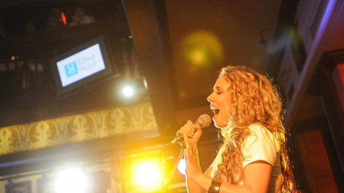"IMAGE DISTRIBUTED FOR HARD ROCK - Haley Reinhart, who placed third in the tenth season of ""American Idol,"" performs at the Under 40 Music Marathon as part of Hard Rock's 12th Annual PINKTOBER breast cancer awareness campaign at Hard Rock Cafe, on Friday, Sept. 28, 2012 in Washington.†(Invision for Hard Rock/AP Images)"