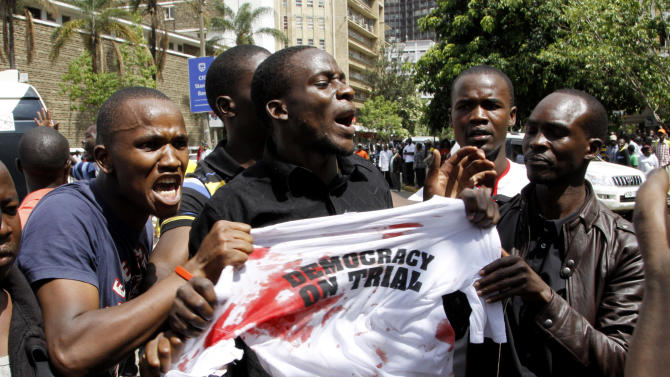 Supporters of Kenya's Prime Minister Raila Odinga protest outside the Supreme Court as a case is filed over claims of massive fraud that took place during the country's March 4 election, in Nairobi, Kenya, Saturday, March 16, 2013. Uhuru Kenyatta won the election with 50.07 percent of the vote. Saturday is the last day Odinga can file a petition to protest the result. Kenya's election has been largely peaceful, unlike the 2007 vote that sparked two months of violence that killed more than 1,000 people. (AP Photo/Khalil Senosi)