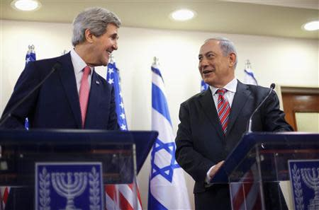 U.S. Secretary of State John Kerry and Israeli Prime Minister Benjamin Netanyahu address a joint news conference at the Prime Minister's Office in Jerusalem