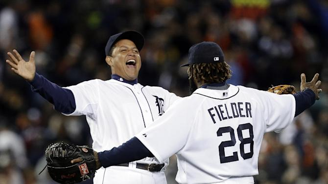 Detroit Tigers' Miguel Cabrera, left, and Prince Fielder (28) celebrate their 5-4 win over the Kansas City Royals in a baseball game in Detroit, Wednesday, Sept. 26, 2012. (AP Photo/Paul Sancya)