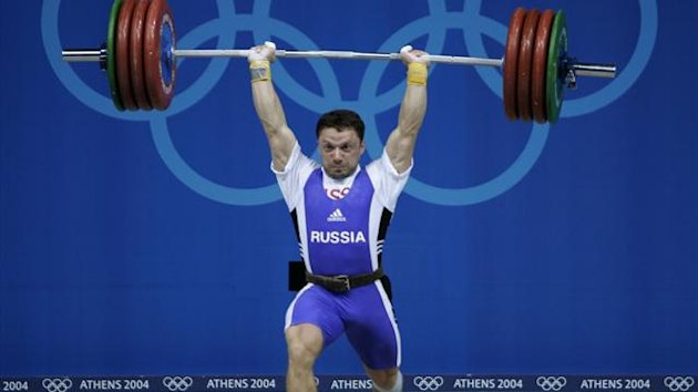Russia's Oleg Perepetchenov powers a lift during the men's 77 kg weightlifting event at the Athens 2004 Olympic Games (Reuters)