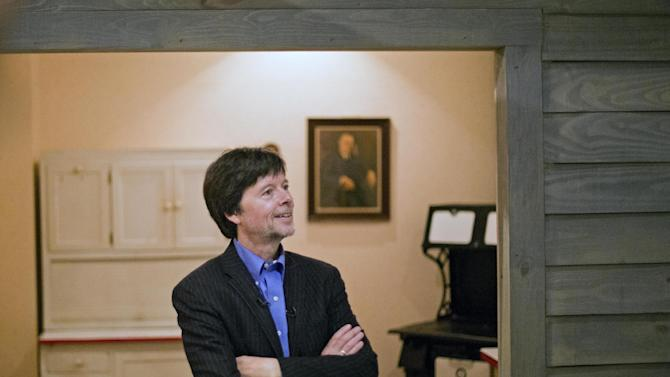 """FILE - In this Nov. 2, 2013 file photo, documentary filmmaker Ken Burns walks through the museum at the Georgia home used by former President Franklin D. Roosevelt in Warm Springs, Ga. FDR, first lady Eleanor Roosevelt and another Roosevelt who occupied the White House as president, Theodore Roosevelt, are the subjects of a new Burns documentary for public television, """"The Roosevelts: An Intimate History."""" PBS said the seven, two-hour episodes that aired last month had an average audience of 9.2 million viewers. The most popular was the first night, on Sept. 14, which had 11.7 million viewers, according to the Nielsen company. (AP Photo/David Goldman, File)"""