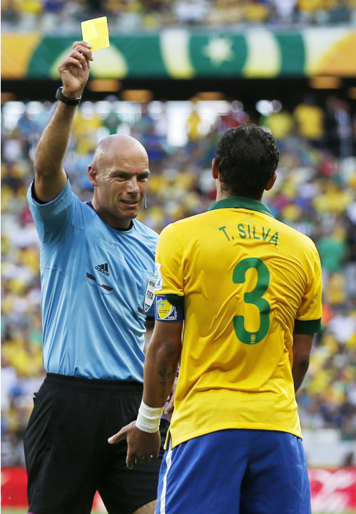 Brazil's Thiago Silva, right is booked by referee Howard Webb from England during the soccer Confederations Cup group A match between Brazil and Mexico at Castelao stadium in Fortaleza, Brazil, Wednes