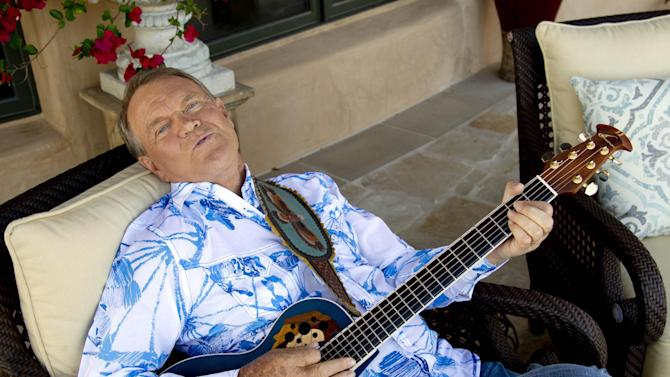 "This July 27, 2011 photo shows musician Glen Campbell in Malibu, Calif.  .  Campbell, who was diagnosed with Alzheimer's disease is planning a farewell tour before retiring from the music.  Campbell is canceling his tour of Australia and New Zealand with Kenny Rogers next month for health reasons. A spokeswoman says Campbell is not up for ""the very long flight that it would require."" The 76-year-old is battling Alzheimer's disease. It would have been Campbell's last international stop on his ""Goodbye Tour."" (AP Photo/Matt Sayles)"