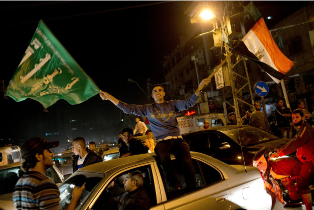 Palestinians celebrate the cease-fire between Hamas and Israel in Gaza City, Wednesday, Nov. 21, 2012. Israel and the Hamas militant group agreed to a cease-fire Wednesday to end eight days of the fie
