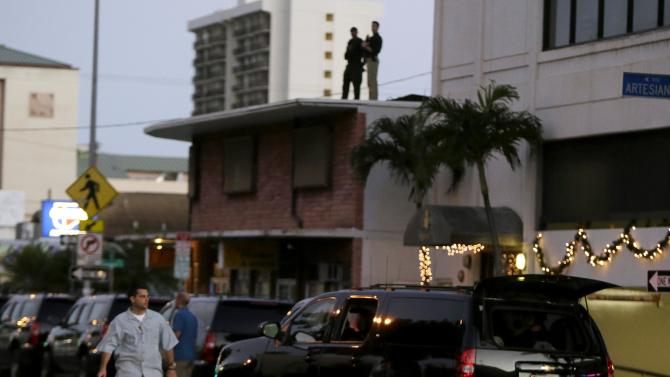 US President Obama's motorcade and security outside of Alan Wong's Restaurant during Hawaiian holiday vacation
