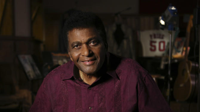 Country music legend Charley Pride smiles for a portrait at his recording studio in Dallas, Texas, Monday, Sept. 24, 2012. The Smithsonian has selected Pride to be part of the new National Museum of African American History and Culture opening in 2015 with Pride  giving the museum items from his life. (AP Photo/LM Otero)