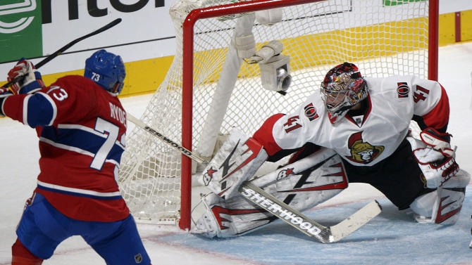 Ottawa Senators' goaltender Craig Anderson, right, is scored on by Montreal Canadiens' Michael Ryder, left, during second-period NHL hockey Game 2 first-round playoff action in Montreal, Friday, May 3, 2013. (AP Photo/The Canadian Press, Graham Hughes)