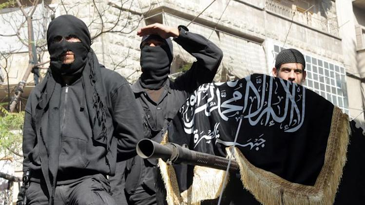 A picture taken on October 25, 2013 shows members of jihadist group Al-Nusra Front taking part in a parade in Aleppo
