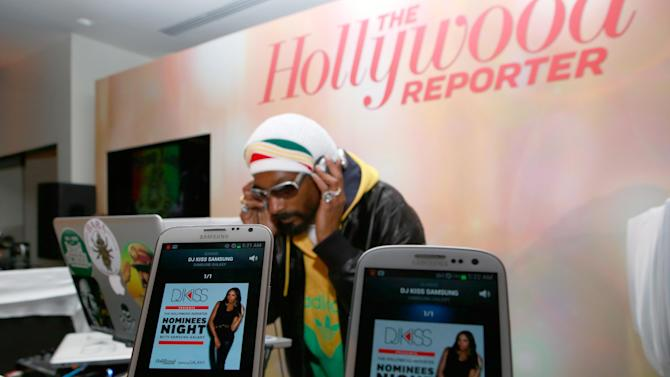 Snoop Dogg AKA Snoop Lion performs at The Hollywood Reporter Nominees Night Presented by Samsung Galaxy at Spago on Monday, Feb. 4, 2013, in Beverly Hills, Calif. (Photo by Ben Cohen/Invision for The Hollywood Reporter/AP Images)