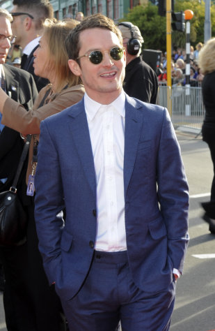 "Elijah Wood who plays Frodo poses on his arrival for the premiere of ""The Hobbit: An Unexpected Journey,"" at Embassy Theatre in Wellington, New Zealand, Wednesday, Nov. 28, 2012. (AP Photo/SNPA, Ross Setford) NEW ZEALAND OUT"