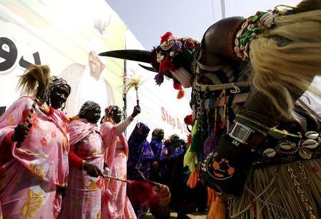 Traditional dancers perform outside the parliament before Sudan's President al-Bashir takes an oath during his presidential inauguration ceremony for a new term at the National Assembly in Omdurman