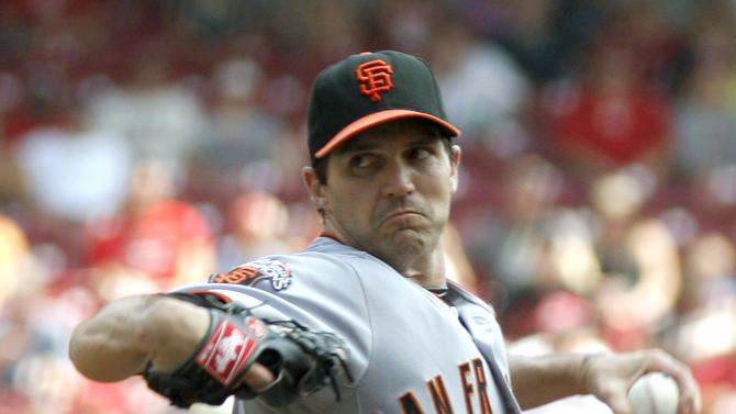 San Francisco Giants pitcher Barry Zito throws against the Cincinnati Reds in the first inning during a baseball game on Sunday, July 31, 2011, in Cincinnati. (AP Photo/David Kohl)