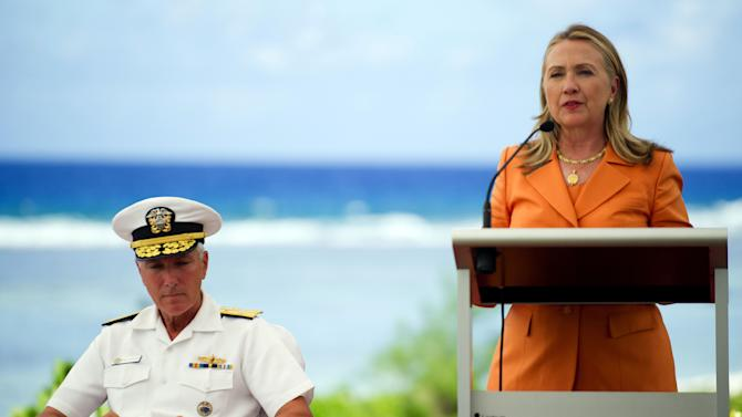 U.S. Secretary of State Hillary Rodham Clinton speaks as U.S. Navy's Pacific Command Commander Adm. Samuel J. Locklear III, left, listens during an event on peace and security in the Pacific, in Rarotonga, Cook Islands, Friday, Aug. 31, 2012. (AP Photo/Jim Watson, Pool)