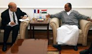 French Defence Minister Jean-Yves le Drian (L) meets with his Indian counterpart AK Anthony at South Block in New Delhi on February 14, 2013 during the two-day state visit by French President Francois Hollande