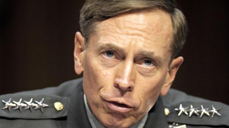 FILE - In this June 23, 2011 file photo, then-CIA Director-desigate Gen. David Petraeus testifies on Capitol Hill in Washington. Petraeus has resigned because of an extramarital affair.  (AP Photo/Cliff Owen, File)