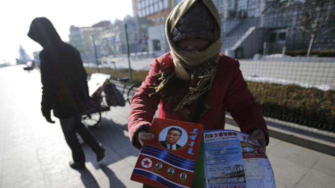 In this Feb. 7, 2013 photo, a Chinese woman sells North Korean souvenirs in Dandong, China, opposite the North Korean town of Sinuiju. China's patience with North Korea is wearing thin, and a widely-expected nuclear weapons test by the latter could bring that frustration to a head. Beijing signaled its growing unhappiness by agreeing to tightened U.N. sanctions after North Korea launched a rocket in December, eliciting harsh criticism from Pyongyang and comment from China watchers surprised by Beijing's unusually tough line. (AP Photo/Eugene Hoshiko)