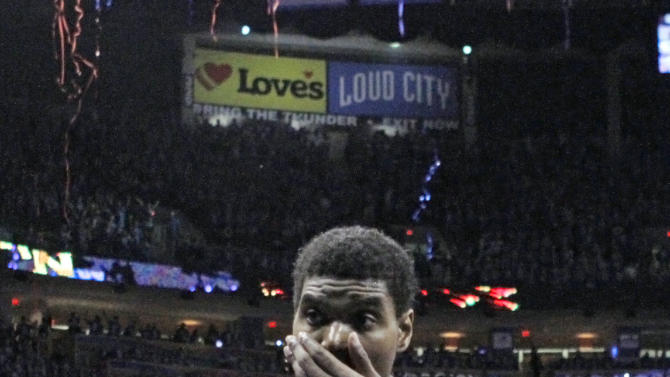 Los Angeles Lakers' Andrew Bynum walks off the court after the Lakers lost 106-90 to the Oklahoma City Thunder during Game 5 in their NBA basketball Western Conference semifinal playoff series, Monday, May 21, 2012, in Oklahoma City. (AP Photo/Alonzo Adams)