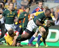 South Africa's Tendai Mtawarira (R) attempts a try during their Rugby Championship Test match vs Wallabies, in Perth, on September 8. South Africa are second on the championship table but have only one win to their credit, and have drawn and lost their last two games