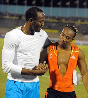 World champion Yohan Blake, right, is congratulated by world-record holder Usain Bolt after Blake defeated Bolt in the 100m final at Jamaica's Olympic trials in Kingston, Jamaica, Friday, June 29, 2012. Blake pulled a stunner finishing in 9.75 seconds to upset Bolt by 0.11 seconds. (AP Photo/Collin Reid)