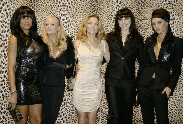 FILE- In this Jan. 14, 2008 file photo, the Spice Girls, from left, Melanie Brown, Emma Bunton, Geri Halliwell Melanie Chishlom and Victoria Beckham pose backstage prior to the start of the Roberto Cavalli Fall/Winter 2008/2009 men&#39;s collection fashion show, in Milan, Italy, (AP Photo/Luca Bruno, File)