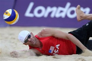 US Jake Gibb dives for a ball during the quarterfinal men's beach volleyball match against Latvia at the 2012 Summer Olympics, Monday, Aug. 6, 2012, i