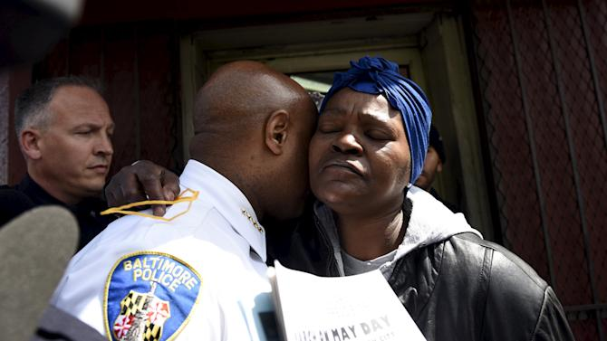 A demonstrator hugs a policeman during a protest in front of Baltimore Police Department Western District against the death in police custody of Freddie Gray in Baltimore