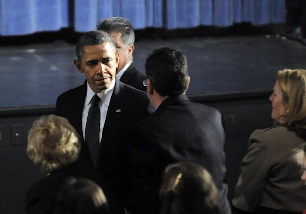President Barack Obama greets Gov. Dannel Malloy during his arrival at the start of an interfaith vigil for the victims of the Sandy Hook Elementary School shooting on Sunday, Dec. 16, 2012 at Newtown