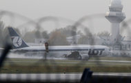 A Boeing 767 of Polish LOT airlines makes an emergency landing at Warsaw airport, Poland,Tuesday, Nov. 1, 2011. The plane was en route from Newark with 230 people onboard but no one was injured. (AP Photo/Czarek Sokolowski)