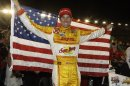 Ryan Hunter-Reay celebrates his victory in the IndyCar auto race at Auto Club Speedway in Fontana, Calif., Saturday, Sept. 15, 2012. (AP Photo/Reed Saxon)